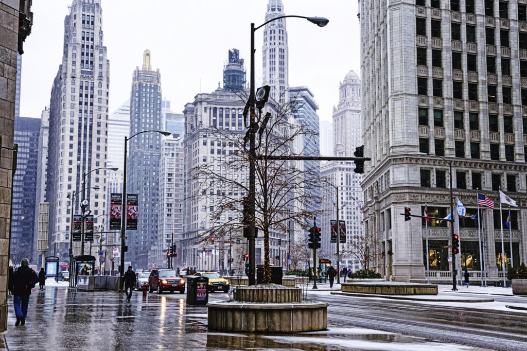 Michigan Avenue on a winter's day, Downtown Chicago. City street with skyscrapers and background people in a snowstorm.
