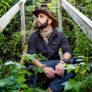 Coyote Peterson-Sits-on-Stairs in Jungle